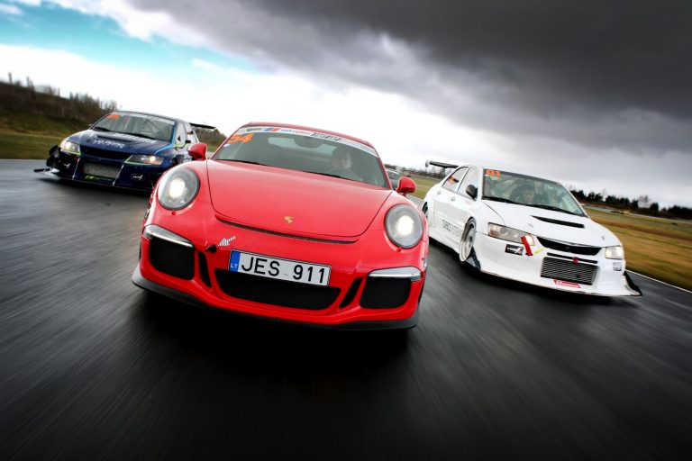 Porsche and two EVO at Drivers Parade before starting FastLap EE Giedrius Matulaitis matulaitis.lt