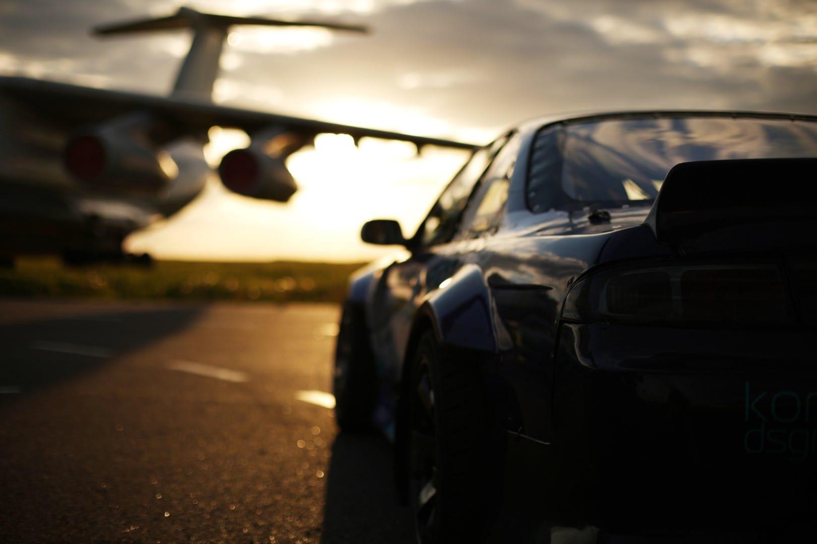 Nissan next to a plane at Mogiliov airport Belarus Giedrius Matulaitis matulaitis.lt